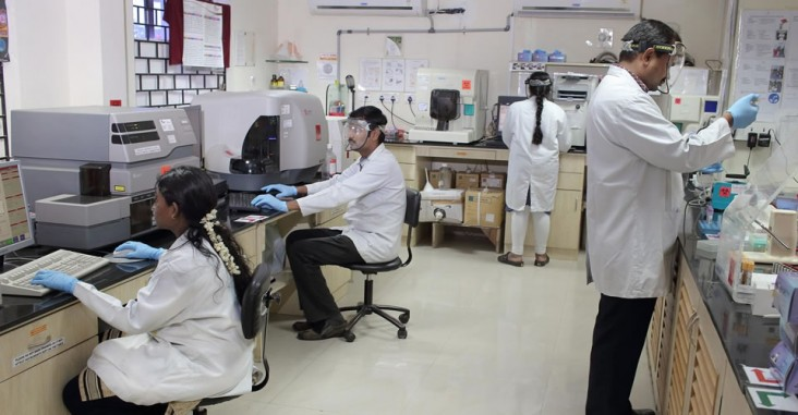 Lab technicians at work at the USAID-supported Infectious Diseases (ID) Laboratory located at the Voluntary Health Services (VHS) Hospital Campus in Chennai, India. These technicians are testing samples from a cohort to identify volunteers with early HIV infection. These samples reveal important clues about the body's immune response to HIV and are key to developing an HIV vaccine. Photo credit: Anirban Dutta/IAVI