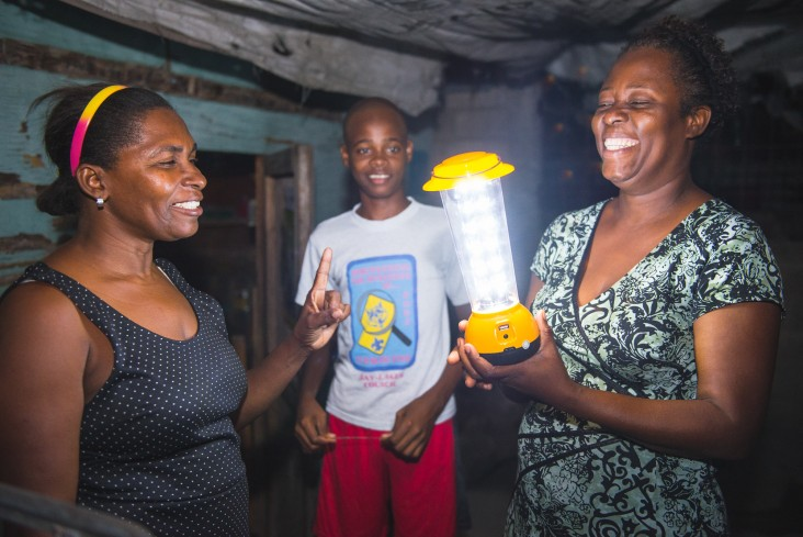 Nancy Goldman, left, explains to customers how to use the solar lamp.