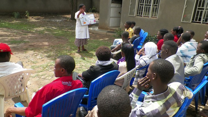 A staff person from the Mbarara clinic runs an education session at the adjacent youth center.