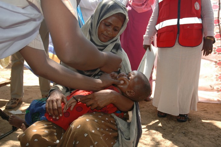 A health worker provides care to a child in Somalia.