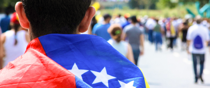 Photo of boy with Venezuelan flag