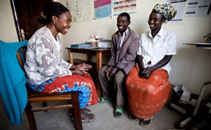 A couple in Uganda receives peer counseling from a community health care worker who has received HIV services.