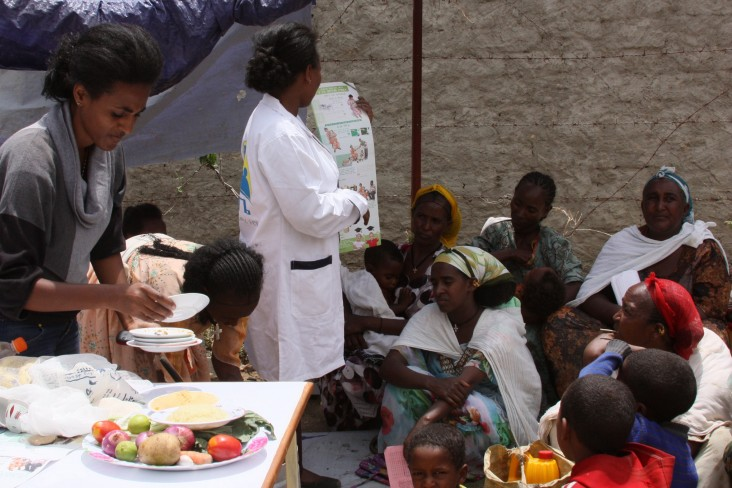 At a Productive Safety Net Program food distribution site in Tigray, food recipients receive nutrition training.