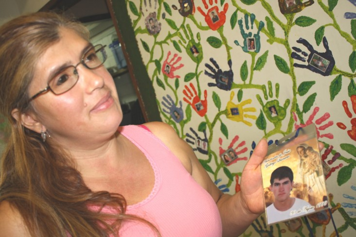 "Amanda Gallego holds a photo of her brother, who was ""disappeared"" more than 16 years ago while in Antioquia, Colombia."