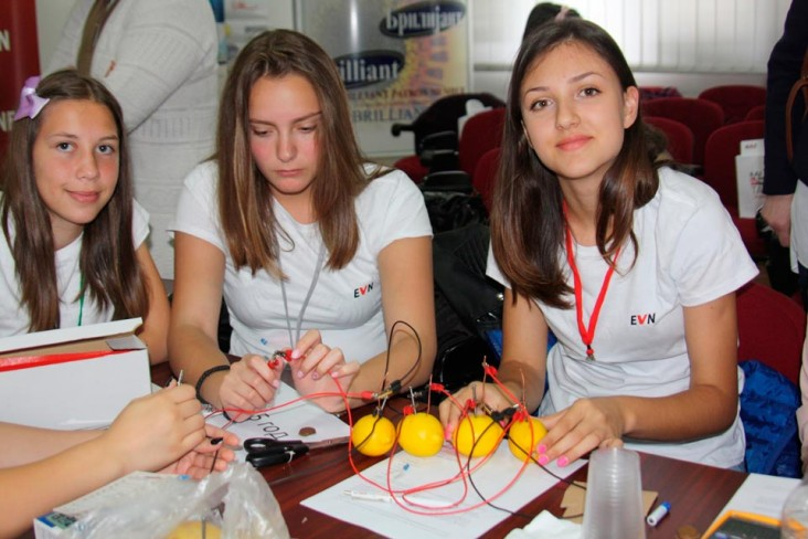 Girls learn how to create electricity from lemons in a hands-on experiment at EVN Macedonia's inaugural Bring Your Daughter to W