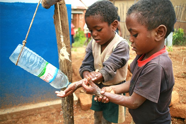 Children in Madagascar use the low cost, low tech, water-conserving tippy tap to wash their hands.