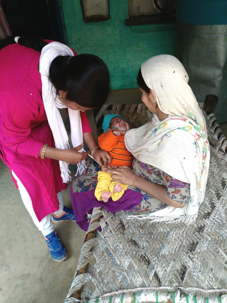 Auxiliary nurse midwife Anju Chauhan administers vaccine to an infant in the Haridwar district of Uttarakhand state.
