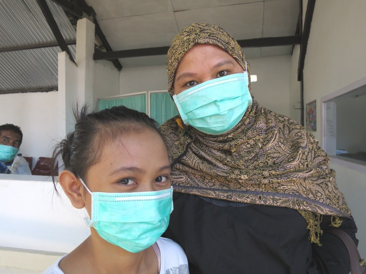 A young girl with multidrug-resistant TB, just beginning treatment, with her mother in Makassar