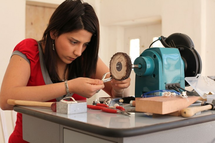 A girl attending a jewelry making course at Dar Al-Kalima College in Bethlehem.