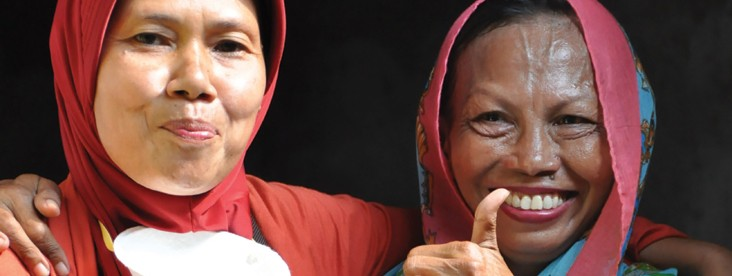 Local Organization Network - A pair of women smile for the camera, one giving the thumbs up sign