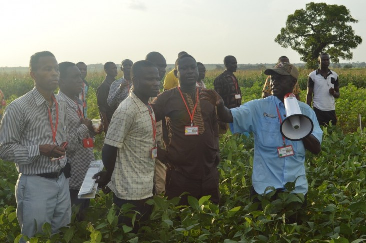 George Awuni, Soybean Innovation Lab SMART Farm manager, right, discusses soybean yields with attendees of the SIL Soybean Kick-off Event in northern Ghana.