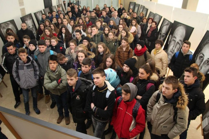 Students at opening of 'Lično (Personal): Portraits of War Victims' exhibition in Jajce, Bosnia and Herzegovina (exhibition supported by the USAID PRO-Future project).