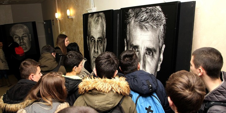 Students in Jajce, Bosnia and Herzegovina, viewing 'Lično (Personal): Portraits of War Victims' exhibition (supported by the USAID PRO-Future project).