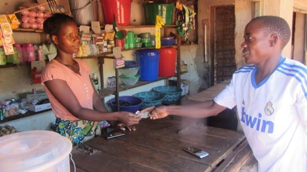 Rita Mbewe has customers from her community, and her income has improved.