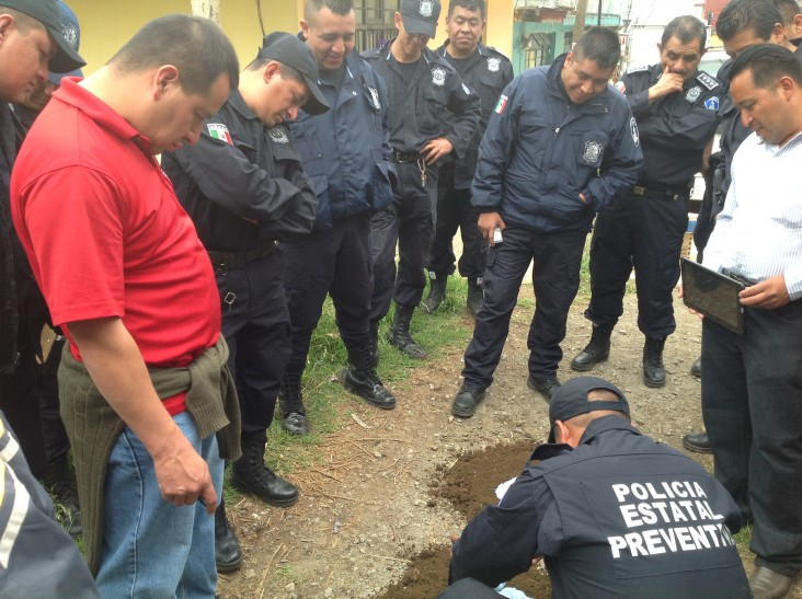 Police Investigators in Mexico practice crime scene processing at the Professional Training Institute of the Secretariat of Publ
