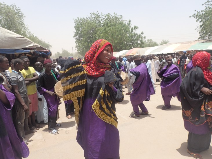 Nigerian woman celebrates the retreat of violent extremist groups in her community