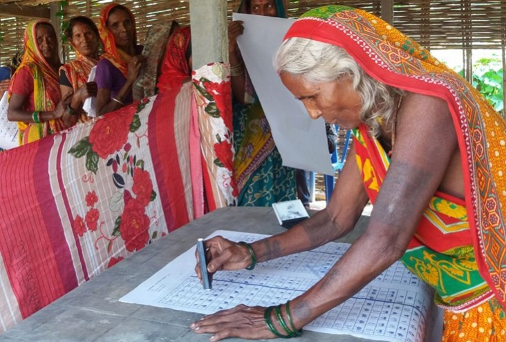 Image of woman learning how to fill out ballot in 2017 elections