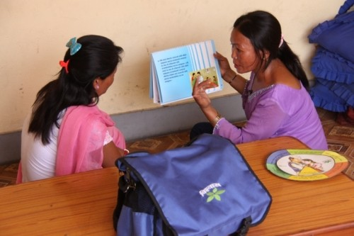 Image of female Nepali outreach worker advising female Nepali sex worker on how to protect herself from HIV and other STIs.