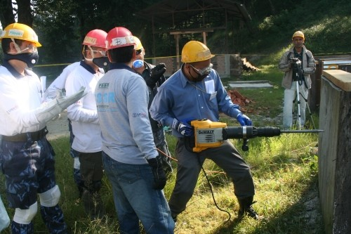 Image of about 5 Nepal men participating in a USAID-supported collapsed structure search and rescue training