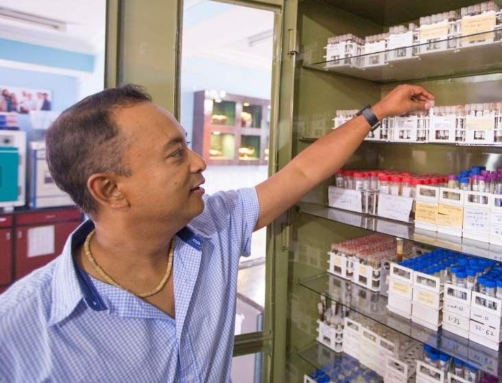 Dibesh Karmacharya inspects the vault of 1,200 tiger scat specimens at the Center for Molecular Dynamics Nepal.