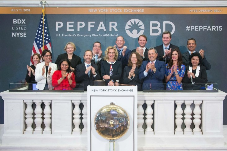 Representatives from PEPFAR, USAID, CDC, and Becton Dickinson ring the opening bell on the floor of the New York Stock Exchange, marking the 15th anniversary of PEPFAR.