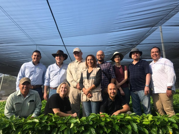 Group inside a greenhouse in Amanalco, State of Mexico