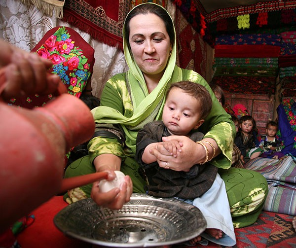 In Afghanistan, mothers are trained in improved hygiene practices as part of USAID's MCHIP project.
