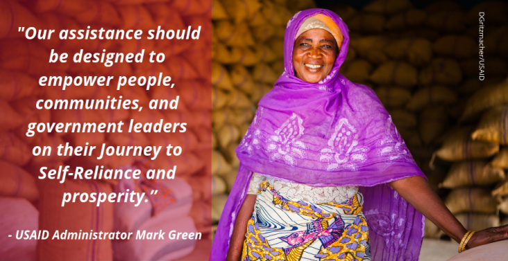 "Image of a woman with quote ""our assistance should be designed to empower people, communities, and government leaders on their Journey to Self-Reliance and prosperity - USAID Administrator Mark Green"""