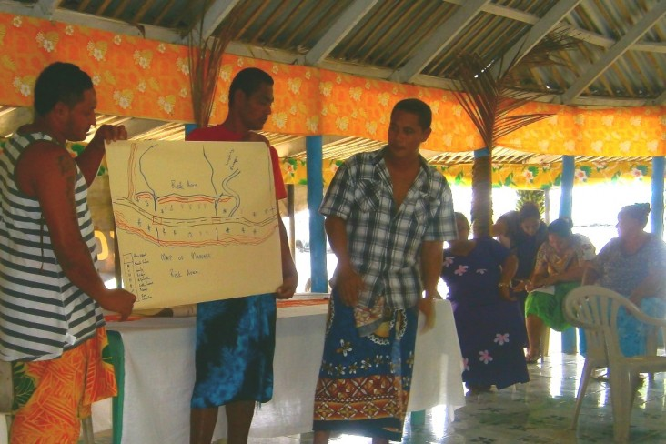 Manase villagers drew maps on large sheets of paper to analyze the layout of their community's assets.