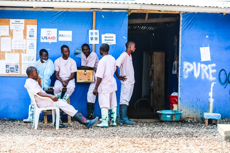 Aid workers rest at the Bong County Ebola Treatment Unit.
