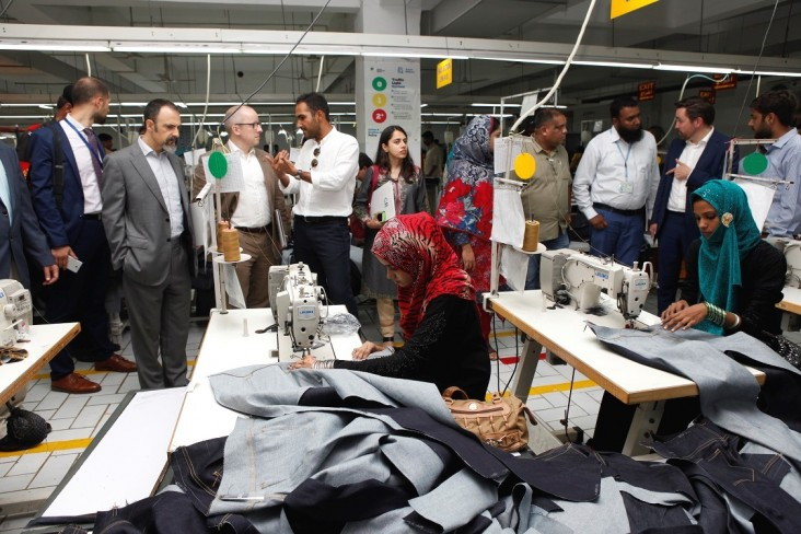 USAID and U.N. Development Program representatives visit a denim factory in Karachi that has partnered with the Youth Employment Project to hire trainees.