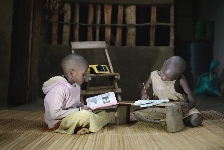 Two students use their Fenix-powered lights to study.