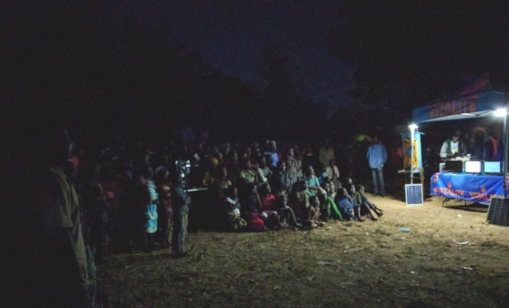 VITALITE hosts its first mobile cinema event to teach farmers how to use mobile money.