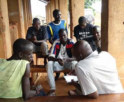 Mentors organize monthly discussion groups and provide a safe space for young men to address challenges and issues of concern.