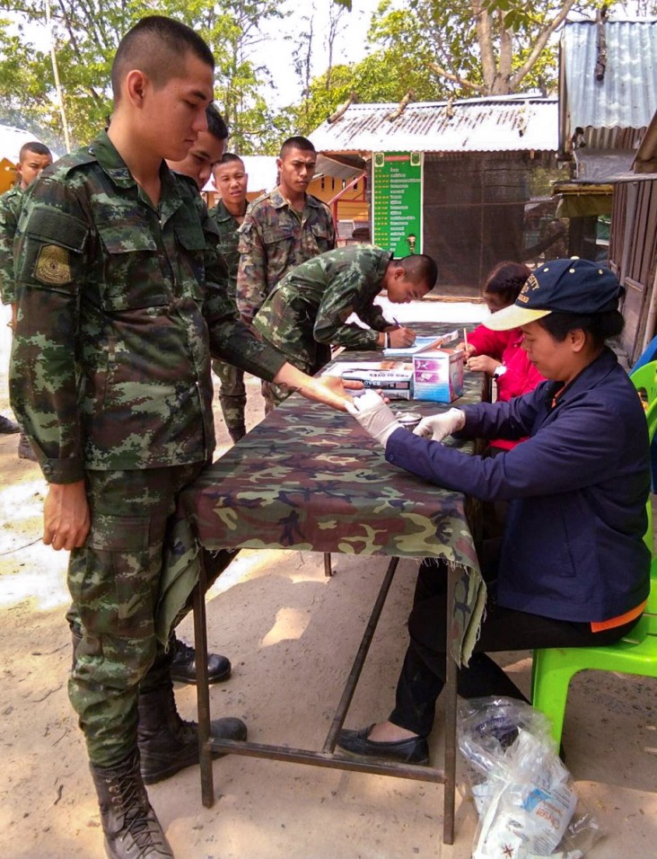 Kanyarat Lausatianragit, right, conducts a mobile malaria clinic for members of the Royal Thai Army on the border between Thailand and Cambodia.