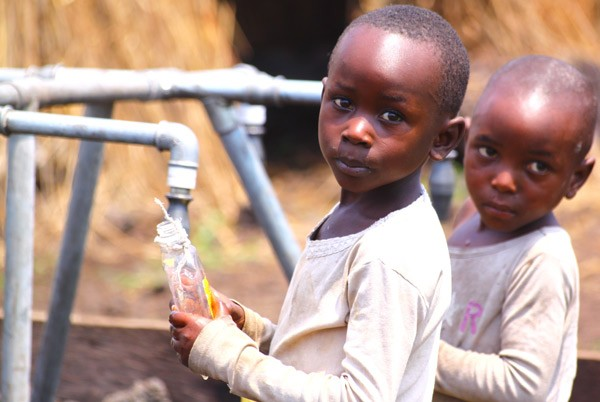 Children collect water at a water point in the Goma area. USAID is working in Goma and other cities throughout DRC to ensure tha