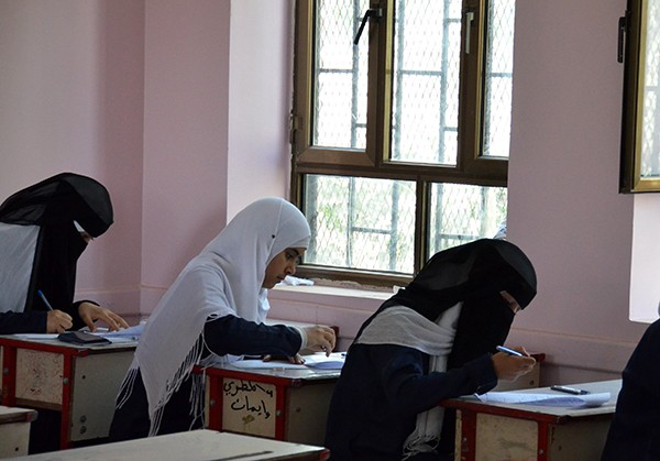 Girls at a newly refurbished school in Yemen take their exams.