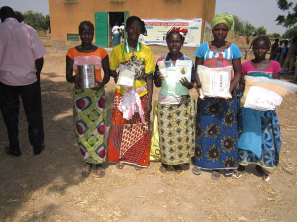Women receive pre-packaged food rations