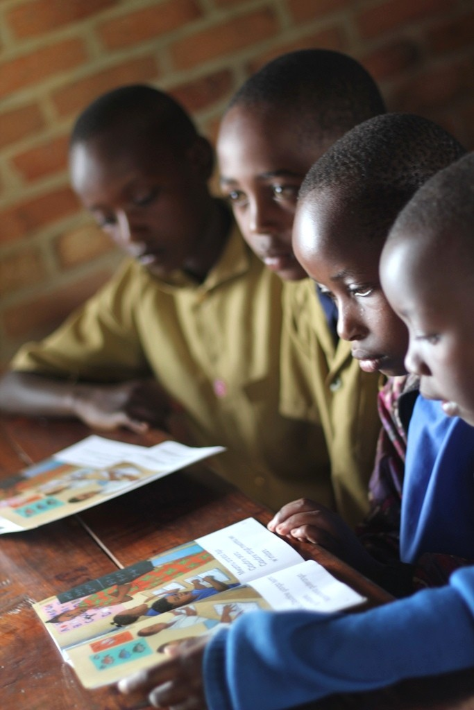 Students read in Beatha Nikuze's third grade classroom at Kanyinya Primary School.