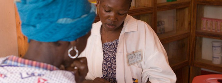 A medical technician talks with a TB patient