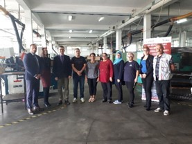 New employees of Saraj-Komerc in Gornji Vakuf, Bosnia and Herzegovina, and USAID WHAM project team following workforce development training.