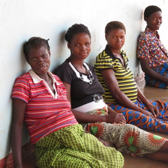 Pregnant women wait to deliver at the Chikomeni Health Center.