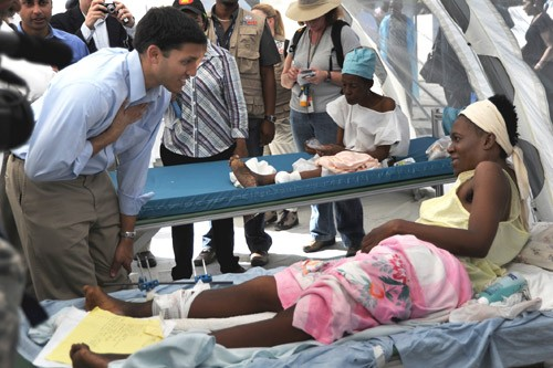 USAID Administrator Rajiv Shah, left, visits a hospital in Port-au-Prince, Haiti, Jan. 23, 2010.