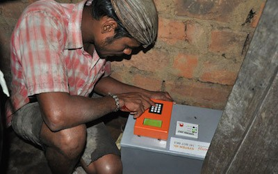 A man checks installation of a Simpa Networks household energy system.