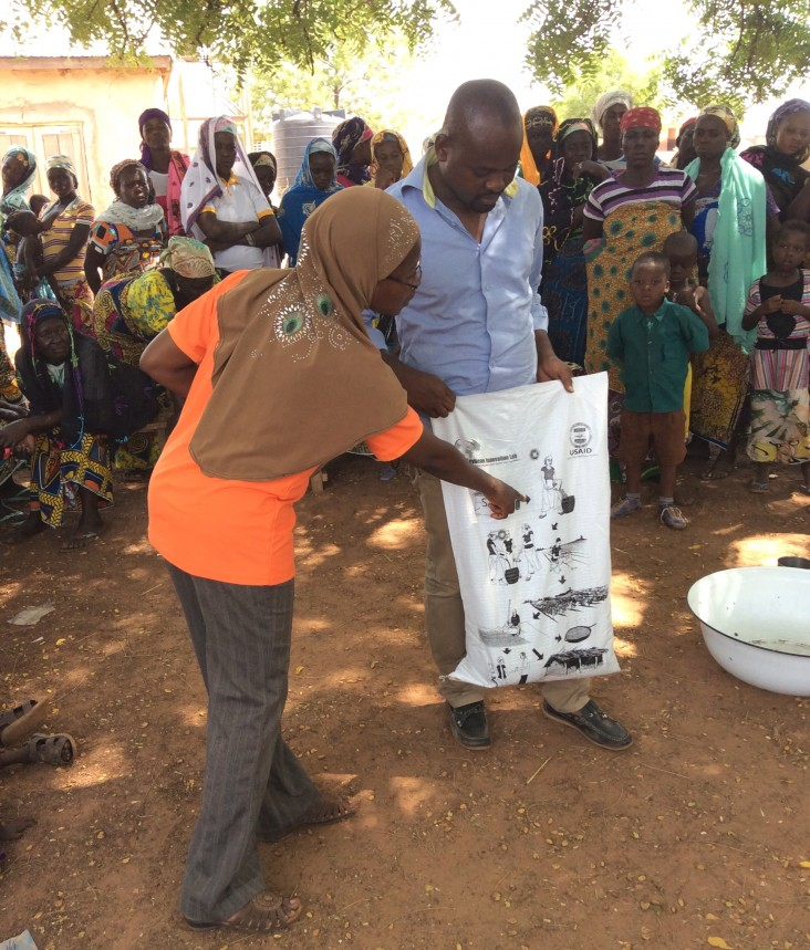 Catholic Relief Services agricultural program and Ministry of Agriculture officers provide soybean agronomic extension to recipients of the soybean success kits in northern Ghana.