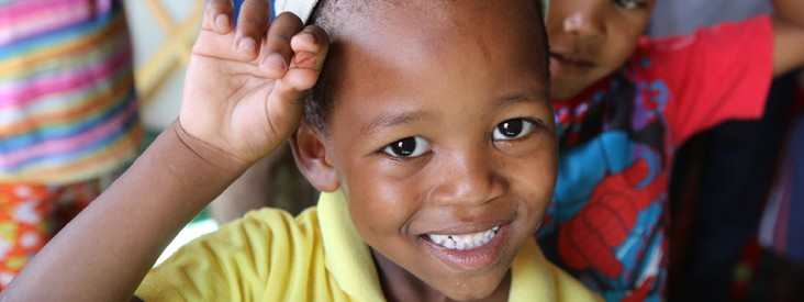 TB Alliance - A child smiles for the camera