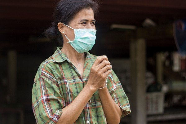 A woman wears a mask to prevent the spread of tuberculosis and multi-drug resistant tuberculosis in Rayong, Thailand.