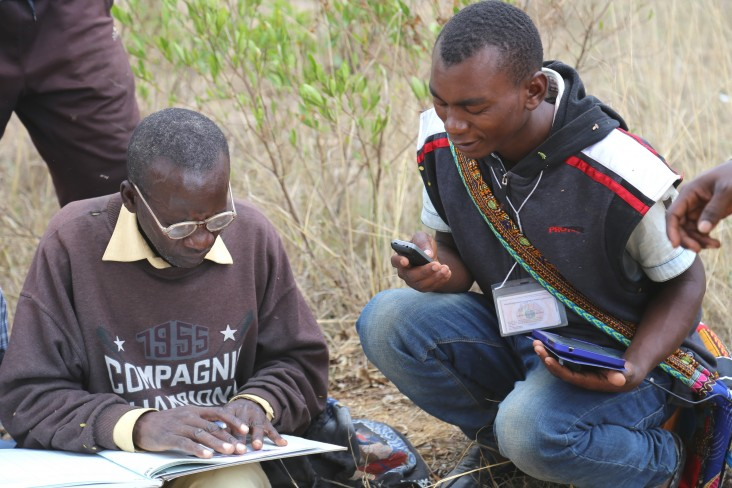 Gaspar Bangi, right, cross-checks data with an adjudicator from the Kiponzelo field surveying team.