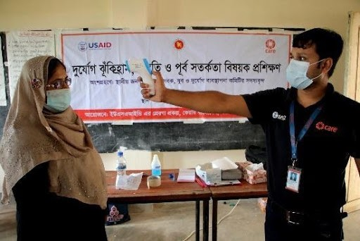 At USAID-sponsored training, volunteers and community members learn their roles and how best to protect and care for vulnerable people , such as ill and people with disabilities, during an emergency.