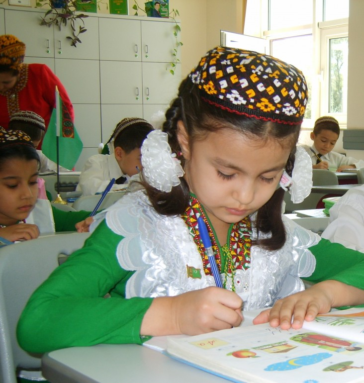 A schoolgirl in Turkmenistan works at her desk.